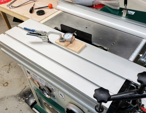 Sled clamped to the sliding table while getting the table motion parallel to the blade